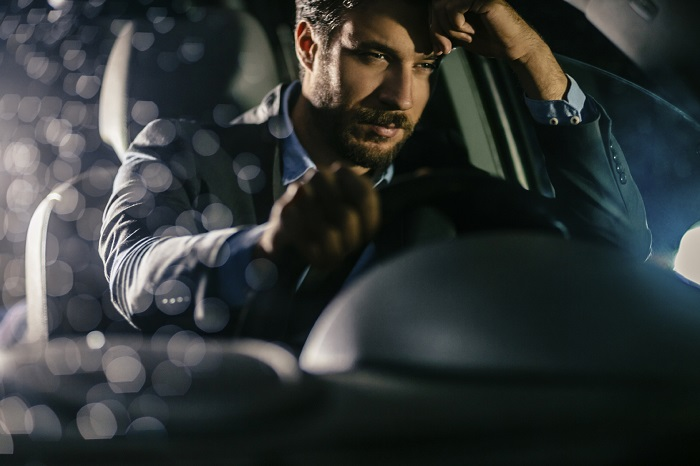 Man driving home drunk and tired